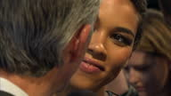 Exterior shots of Alexandra Shipp actress talking to reporter on red carpet at the premiere of X Men Apocalypse on May 09 2016 in London England