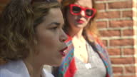 Exterior shots of Amber Tamblyn and America Ferrera addressing Hillary Clinton supporters at a rally at Phoenix College speaking about Arizona being...