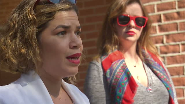 Exterior shots of America Ferrera addressing Hillary Clinton supporters at a rally alongside fellow actress Amber Tamblyn speaking about why she...