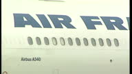 Exterior shots of an Air France airbus A340 plane taxiing on the airfield and close up shots of the engines tail tyres and an Air France plane taking...