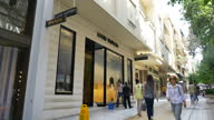 Exterior shots of an HSBC bank branch and a Louis Vuitton and Prada shop in a pedestrianised shopping precinct in Athens on June 05 2015 in Athens...