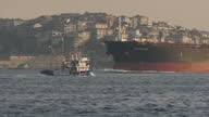 Exterior shots of an oil tanker passing through the Bosphorus Strait with the Istanbul skyline in the background on April 14 2017 in Istanbul Turkey