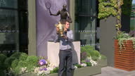 Exterior shots of Andy Murray posing with his Wimbledon trophy in front of the Fred Perry statue the day after winning the Championship Andy Murray...