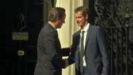 Exterior shots of Andy Murray standing for photograph outside Number 10 Downing Street Murray meets and shakes hands with UK Prime Minister David...