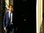 Exterior shots of Andy Murray walking up to outside Number 10 Downing street and posing by door UK Prime Minister David Cameron walks out and shakes...