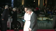 Exterior shots of Angelina Jolie and Jack O'Connell hugging and posing together on the red carpet at the UK premiere of 'Unbroken'>> on November 25...