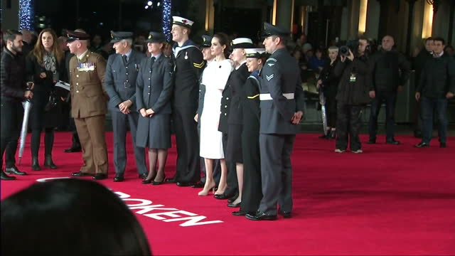 Exterior shots of Angelina Jolie posing with members of the British armed forces on the red carpet at the UK premiere of 'Unbroken'>> on November 25...