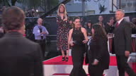 Exterior shots of Anne Hathaway embracing Edith Bowman at the premiere of The Intern in Leicester Square and preparing to speak to members of the...
