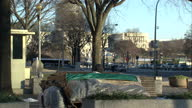 Exterior shots of anonymous homeless people on the streets of Washington DC on a cold winter's day and the Capitol Building shrouded in scaffolding...