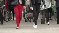 Exterior shots of anonymous people walking along a pavement in Chelsea some wearing skinny jeans and leggings>> on June 23 2015 in London United...