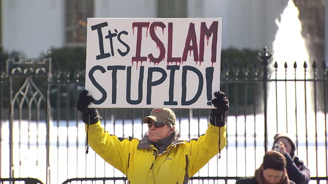 Exterior shots of anti Islamic protesters with banners proclaiming 'It's Islam Stupid' outside the White House on February 18 2015 in Washington DC