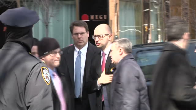 Exterior shots of Anti Putin protesters demonstrating with anti Putin posters near the UN Plaza and Ukraine's interim Prime Minister Arseniy...