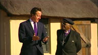 Exterior shots of Archbishop Desmond Tutu walking and chatting with Prime Minister David Cameron on July 07 2011 in Johannesburg South Africa
