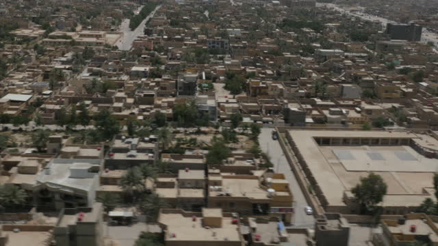 Exterior shots of armed Iraqi Air Force military troops in a helicopter flying over Anbar province looking for ISIS militants activity on May 24 2015...