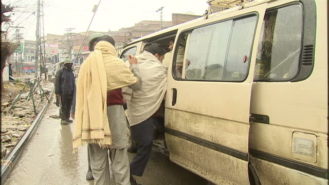 Exterior shots of armed police stop check vehicles driving in Mingora on February 11 2010 in Mingora Pakistan