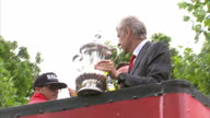 Exterior shots of Arsenal players on an open top bus victory parade including manager Arsene Wenger being interviewed holding the FA Cup on May 31...