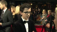 Exterior shots of Asa Butterfield interview at the premiere of Hugo at Leicester Square on November 28 2011 in London England