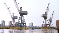 Exterior shots of BAE Systems Scotstoun shipyard showing large cranes and anonymous workers walking across the site Scotstoun Shipyard in Glasgow on...