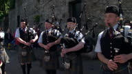 Exterior shots of Bagpipes being played on streets at Edinburgh Diamond Jubilee Party with people celebrating and in festive mood Music enterainment...