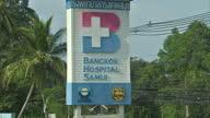 Exterior shots of Bangkok Hospital Samui entrance signs and ambulance on February 02 2016 in Koh Samui Thailand