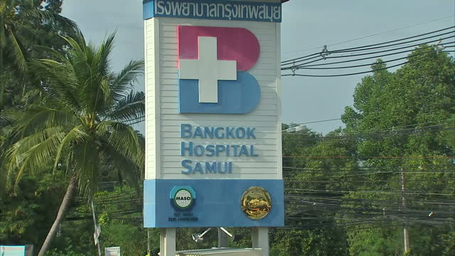 Exterior shots of Bangkok Hospital Samui entrance signs and ambulance on February 02 2016 in Koh Samui Thailand