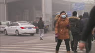 Exterior shots of Beijing commuters wearing face masks to protect against smog pollution Beijing commuters wearing face masks on January 30 2013 in...