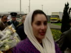Exterior shots of Benazir Bhutto speaking to press and media at airport about war and situation in Serbia and Bosnia Benazir Bhutto speaks about...