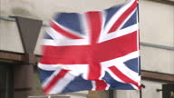 Exterior shots of BNP British National Party EDL English Defence League supporters gathered outside court some draped in St Georges Flag with HANG...
