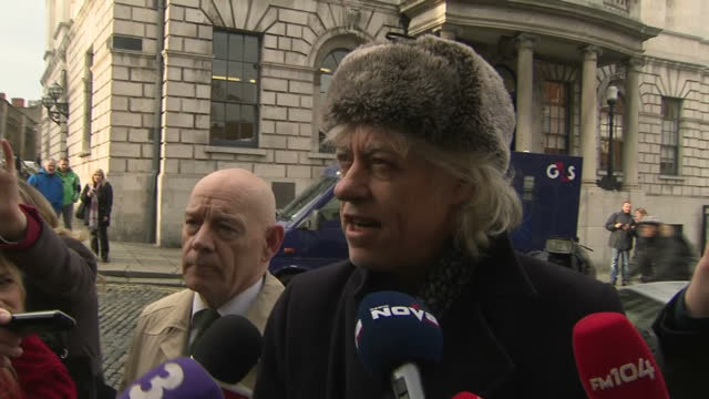 Exterior shots of Bob Geldof arriving at Dublin City Hall and speaking to reporters about his reasons for wanting to return his Freedom of the City...