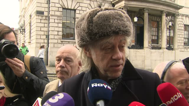 Exterior shots of Bob Geldof speaking to reporters outside Dublin City Hall about his reasons for wanting to return his Freedom of the City of Dublin...