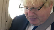 Exterior shots of Boris Johnson boarding a small plane at Southend Airport and on board the flight to Southend reading a newspaper on June 22 2016 in...