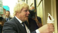 Exterior shots of Boris Johnson campaigning eating ice cream and chatting to local residents ahead of the UK's EU referendum on June 16 2016 in...