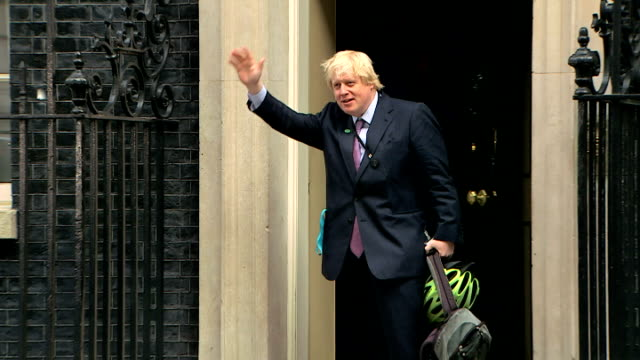 exterior shots of Boris Johnson MP Mayor of London arriving at Downing Street on bicycle and wave before entering number 10 on May 11 2015 in Downing...
