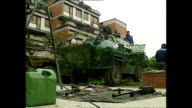 Exterior shots of Bosnian fighters cleaning guns shots of Bosnian army tank and fighters standing in observation position in the woods in July 1992...
