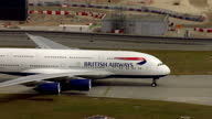 Exterior shots of British Airways plane taxiing along the runway with BA logo on side of plane and on tail fin BA Plane taxiing on runway at Heathrow...
