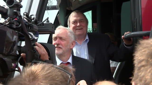 Exterior shots of British Labour Party Leader Jeremy Corbyn posing for photo op with John Prescott by the battlebus surrounded by supporters whilst...
