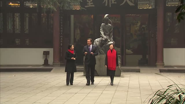 Exterior shots of British Prime Minister touring the grounds of the Du Fu Cao Tang museum and park in Chengdu and viewing the statue of Tang Dynasty...