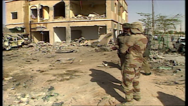 Exterior shots of bulldozers clearing rubble from collapsed buildings after an Iraqi Scud missile strike on the city of Hafr AlBatin as locals an...