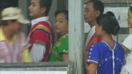 Exterior shots of Burmese people queueing at a rural polling station and casting their votes in the nation's parliamentary elections on April 01 2012...