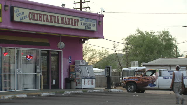 Exterior shots of businesses and traffic around Tucson Arizona passing a tyre garage and branch of Mariscos Chihuahua Mexican restaurant as a Tucson...