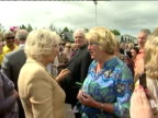 Exterior shots of Camilla Duchess of Cornwall meeting people in Chatham and talking to locals including mother and children Camilla meeting members...