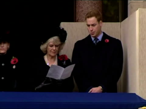 exterior shots of Camilla Duchess of Cornwall standing on a balcony with Prince William during the Remembrance Day parade
