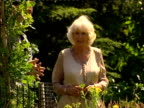 Exterior shots of Camilla Duchess of Cornwall walking around Sir Harold Hillier Gardens being shown various plants and flowers around the Garden...