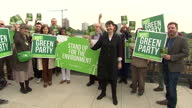 Exterior shots of Caroline Lucas Coleader of the Green Party posing with a group of campaigners holding up copies of the newly launched Environment...