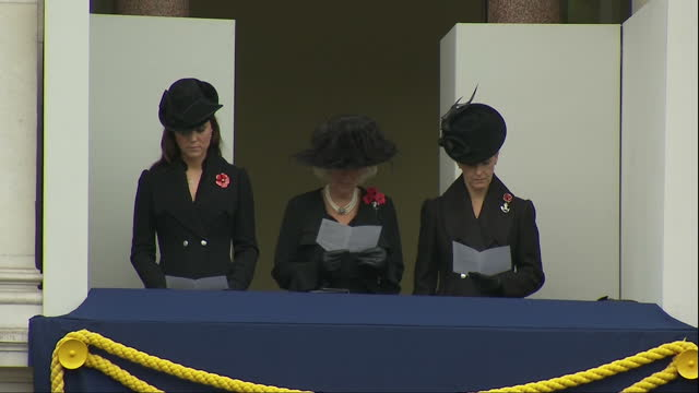 Exterior shots of Catherine Duchess of Cambridge Camilla Duchess of Cornwall and Sophie Countess of Wessex stood on a balcony reading prayer cards...