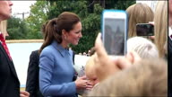 Exterior shots of Catherine Duchess of Cambridge meeting well wishers shaking hands bending over to speaking to parents with children on April 10...