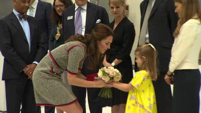 Exterior shots of Catherine Duchess of Cambridge speaking to officials and being presented with a posy of flowers by a little girl as she visits the...