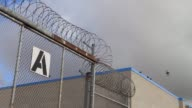 Exterior shots of chain link fences and barb wire lining the perimeter of the Richard J Donovan Correctional Facility in San Diego California Shot of...