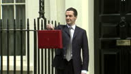 Exterior shots of Chancellor George Osborne posing outside Number 11 Downing Street with the red budget box before departing>> on March 18 2015 in...
