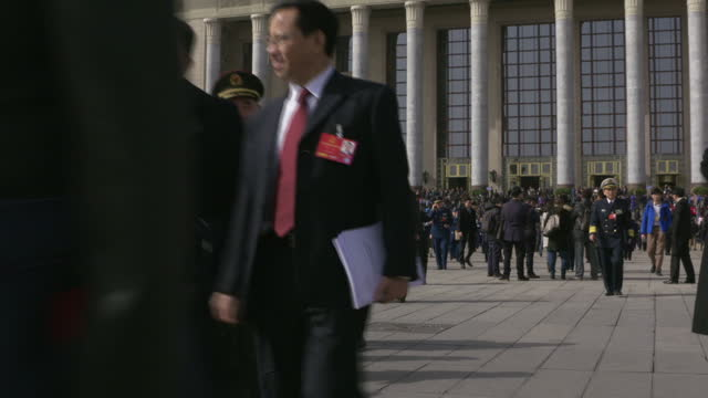 Exterior shots of Chinese officials departing the Great Hall of the People in Tiananmen Square during the first day of the 12th National People's...
